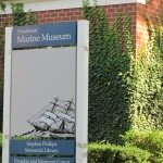 Ship on a blue and white sign for the museum