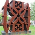 Love spelled out four times in brown is this sculpture.