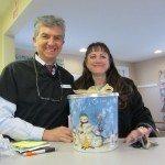Leigh Smith brings Christmas gifts to Seasons of Smiles Dental