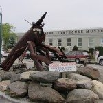 """""""World's Largest Lobster"""" at the Tradewinds Motor Inn in Rockland, Maine. The Maine Lighthouse Museum in is the background."""