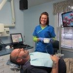 Before we remove the two lower teeth, we have Anastasia check Michael's blood Pressure.