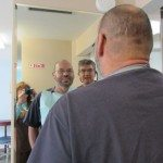 Using the big mirror helps us get an idea what the denture is going to look like.