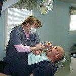 Dara takes photos of the lower mandibular arch.