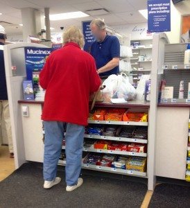 Waiting in line to have my prescription filled at the local pharmacy.