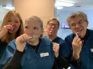 dental team learning proper oral hygiene techniques