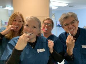 Camden, ME dental team learns how to brush their teeth.
