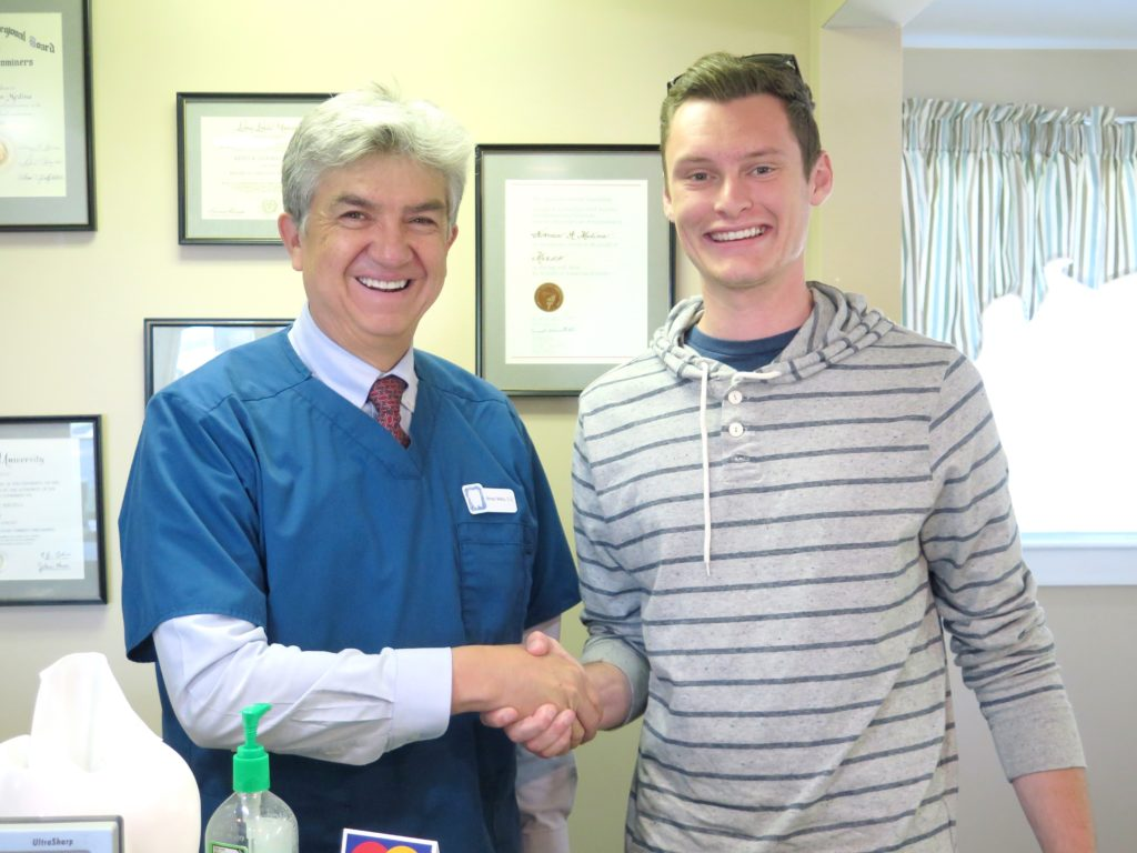 Justin Robinson with Dr. Medina